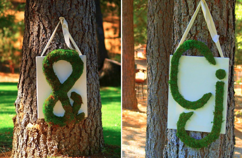 Rustic-glamping-wedding-inspiration-moss-initials-hung-on-trees.full