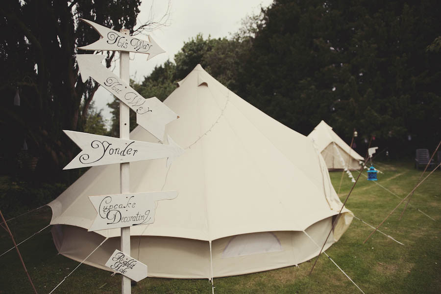 Glamping-vintage-wedding-outdoors-tents-and-unique-signs.full