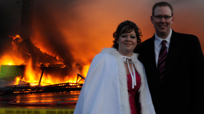Sensational real wedding photos- bride and groom pose as fire blazes in background