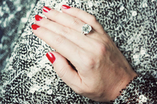 Tiffany and Co diamond engagement ring dazzles with classic red nails