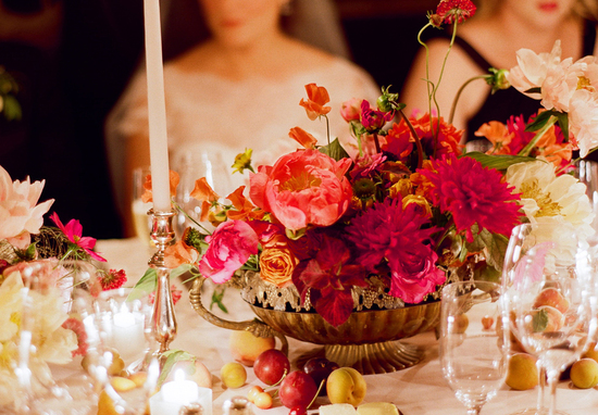Romantic wedding reception tablescape with red peony centerpiece