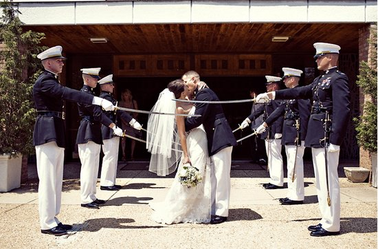 Real weddings with military grooms in uniform- bride groom kiss beneath military sword arch