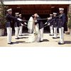Bride-groom-kisss-military-groomsmen.square