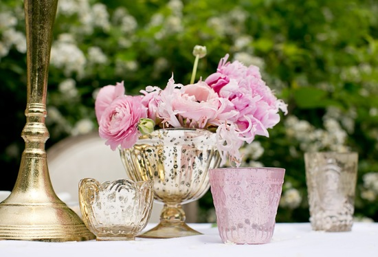 DIY wedding centerpiece with pink ranunculus and peonies in mercury glass vases