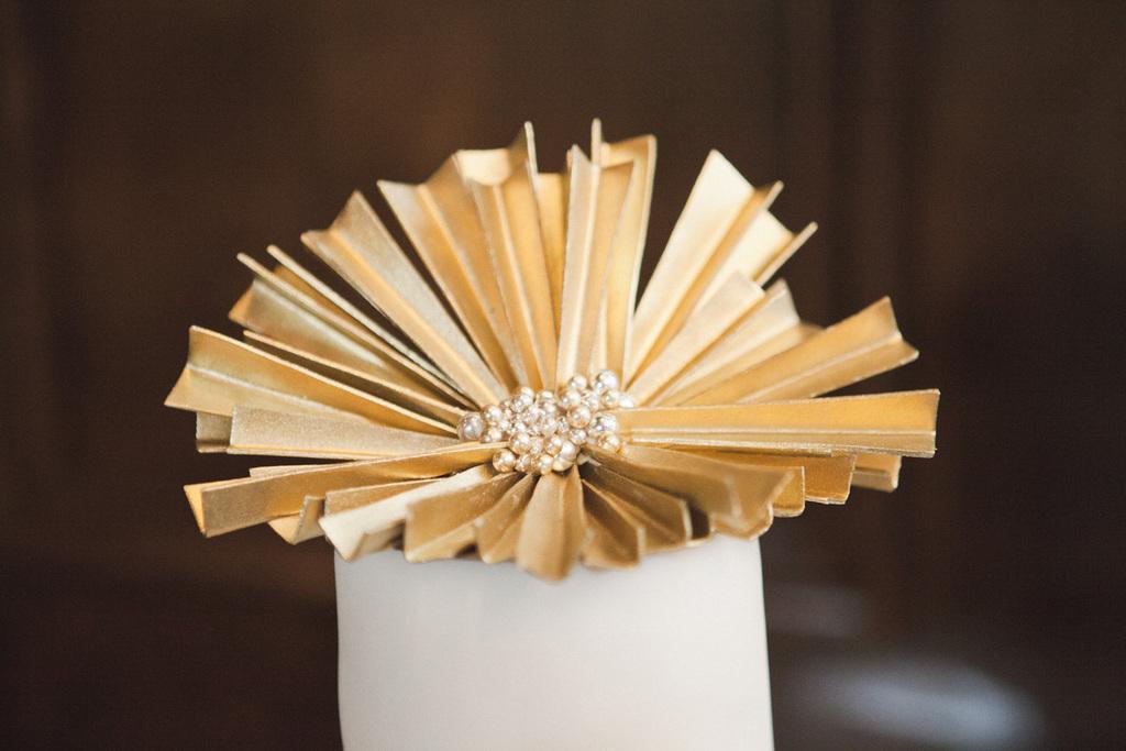 Gold-topped-art-decor-wedding-cake.full