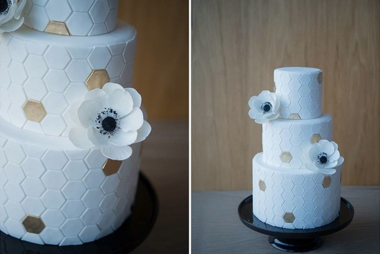 White honeycomb wedding cake with gold accents