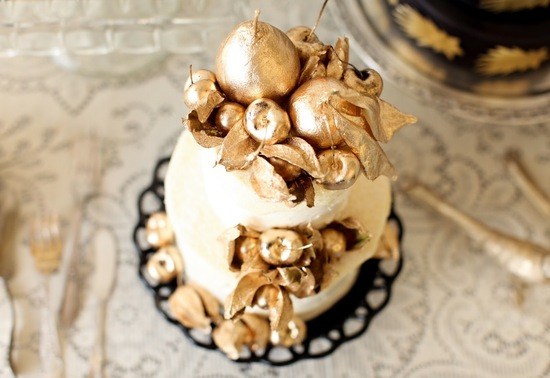 Classic wedding cake topped with gold fruit