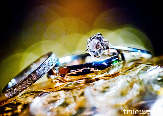 Sparkling engagement ring with wedding bands photo