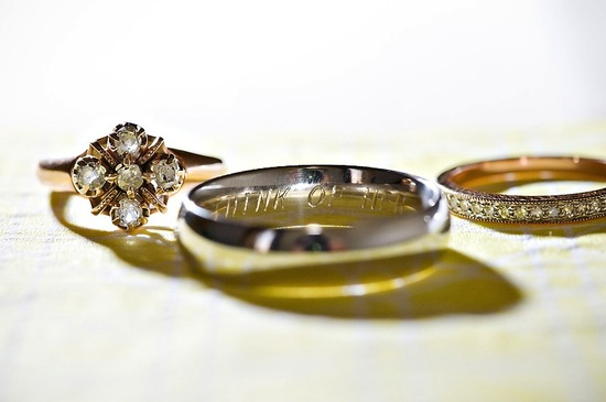 Amazing wedding ring photo showing sweet engraving inside grooms band