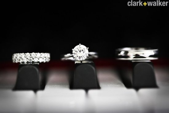 engagement ring and wedding bands on piano keys