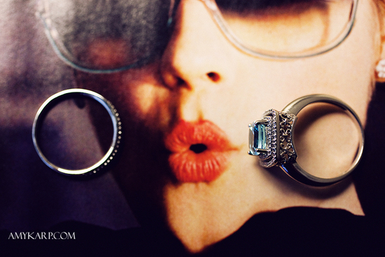 awesome wedding photo of rings atop vintage vogue magazine