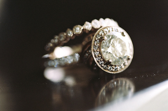halo engagement ring photographed with diamond wedding band