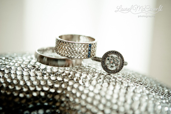 engagement ring and wedding bands atop crystal encrusted heels