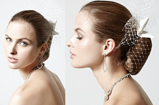 vintage-inspired wedding updo with bow-adorned birdcage veil