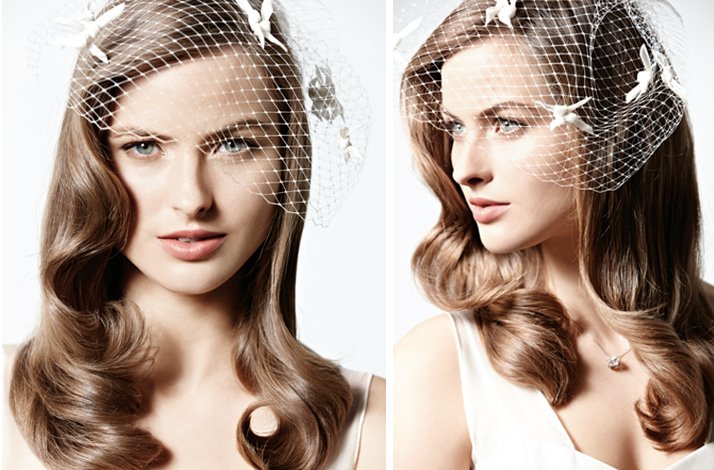 Vintage inspired wedding wavy hairstyle with birdcage veil