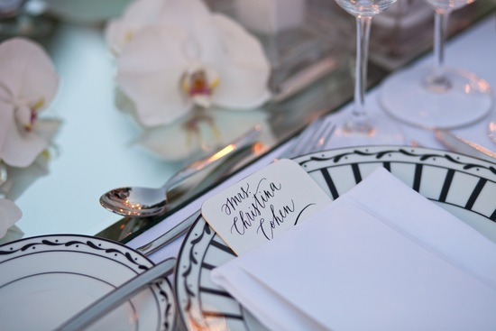 Elegant black and white deco inspired wedding place setting