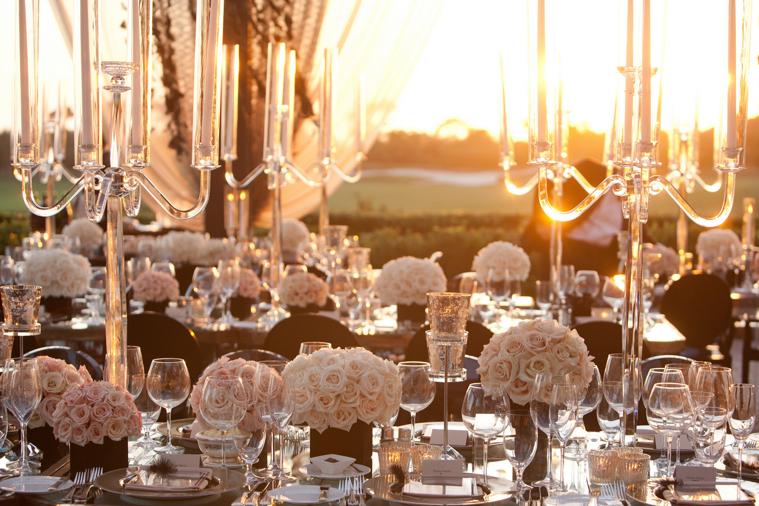Sunset wedding reception with modern candelabras and