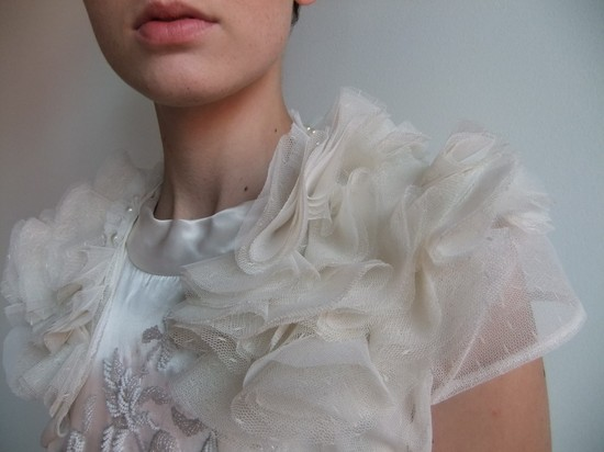 Ivory tulle bridal caplet with pearl accents