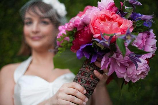 Coral pink and purple peony wedding bouquet