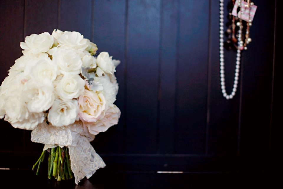 Ivory and blush romantic wedding bouquet with lace ribbon wrap