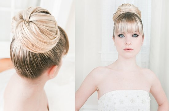 Blonde bride wears high ballerina bun