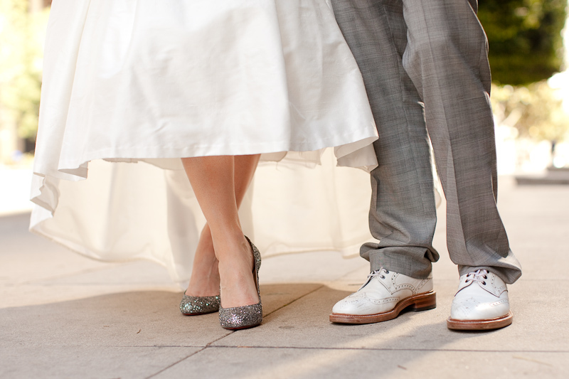 Bride-wears-white-wedding-dress-sparkly-wedding-shoes.full