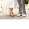 Bride-wears-white-wedding-dress-sparkly-wedding-shoes.square
