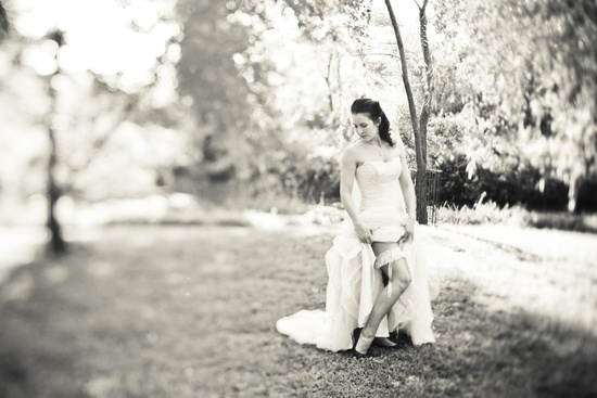 Fall wedding in Georgia- black white photo, bride shows off garter