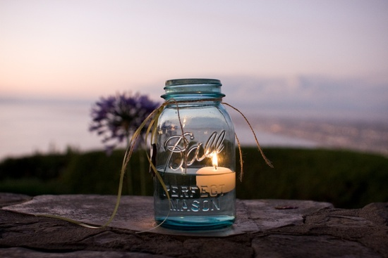 Wedding reception decor using mason jars- with romantic candles