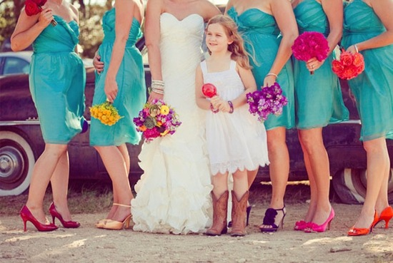 Bridesmaids wear bright mix and match heels with aqua frocks