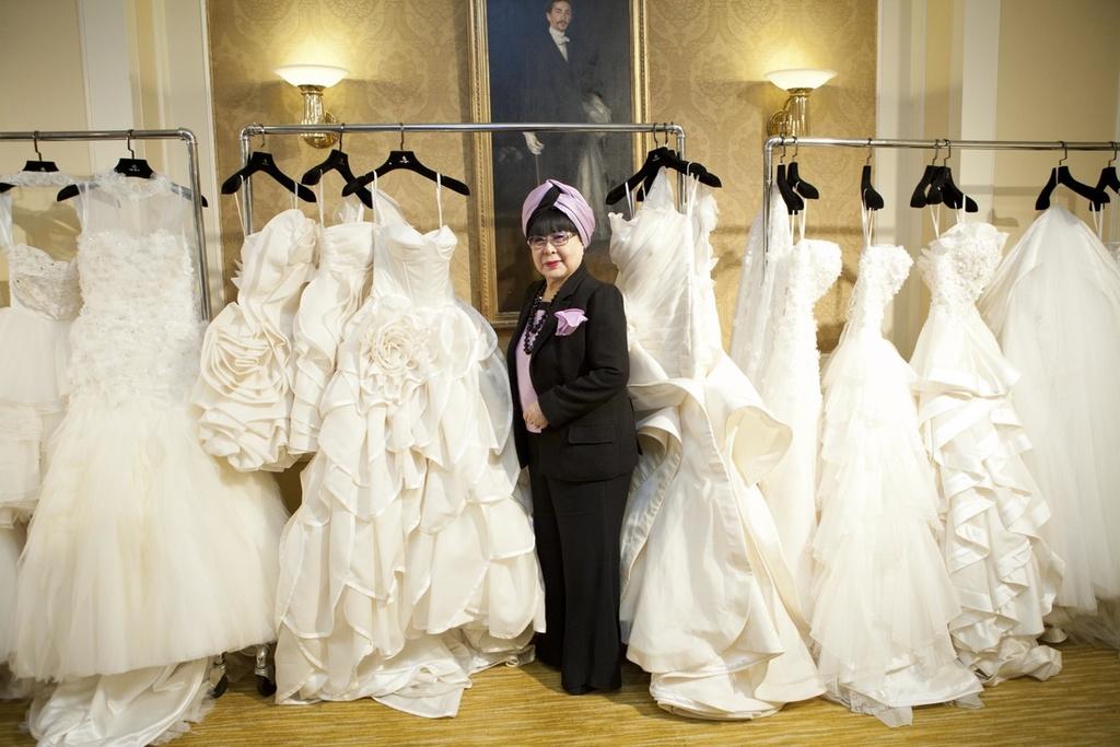 designer yumi katsura poses with 2012 wedding dresses