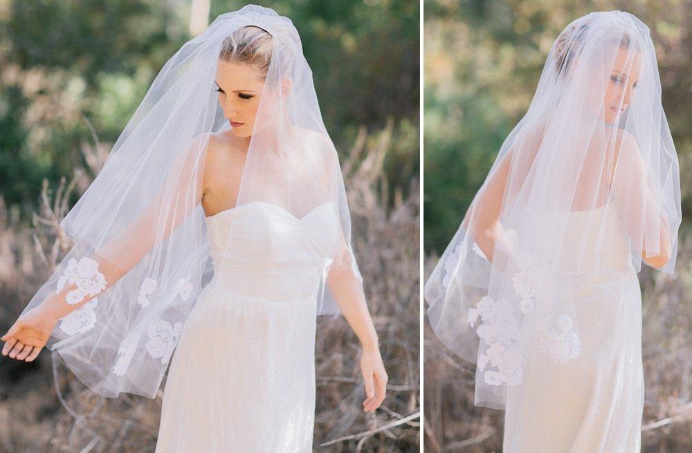 Tulle-fingertip-veil-with-floral-applique-trim.full