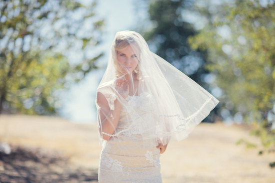 Elbow length drop wedding veil with delicate lace trim