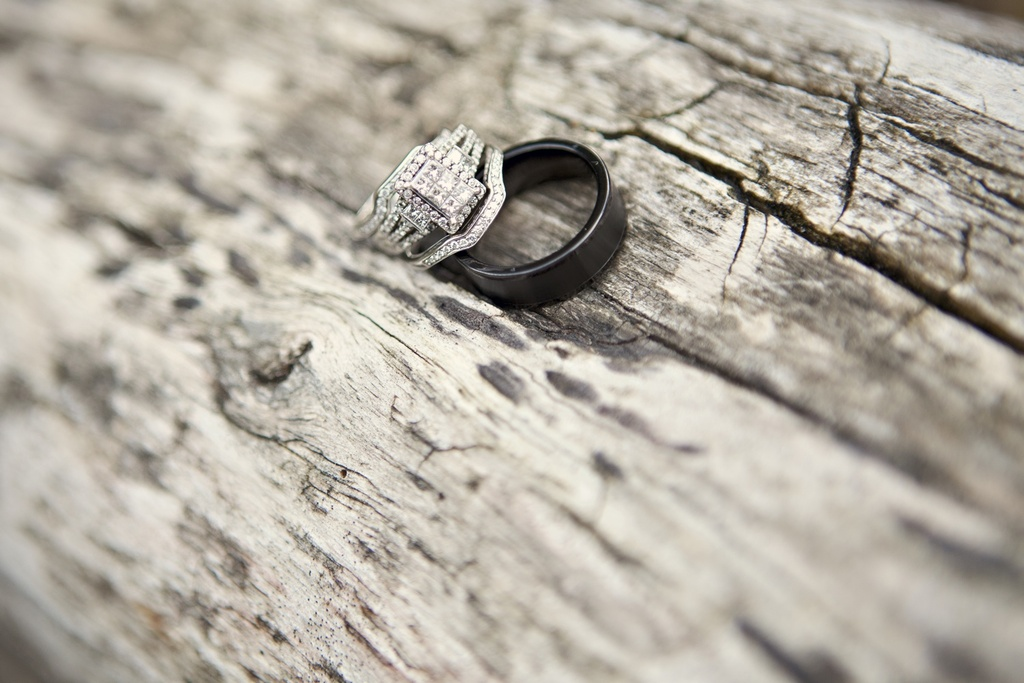 Bride's engagement ring photographed with groom's wedding band