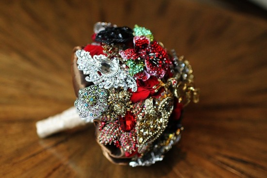 photo of Ruby red bridal brooch bouquet by Amanda Heer