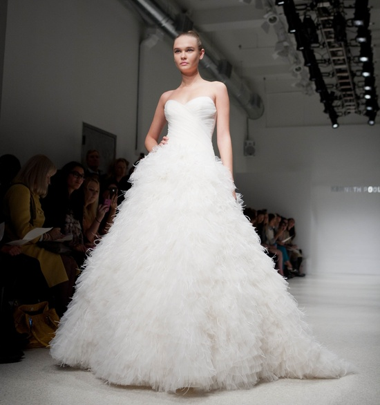 Feather adorned ball gown wedding dress