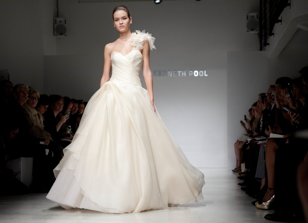 Ivory one-shoulder ballgown wedding dress