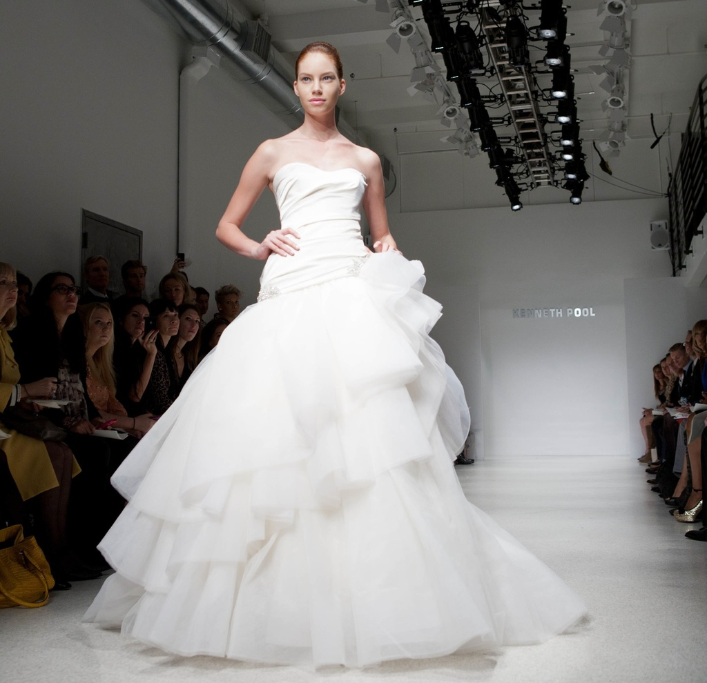 White strapless tulle ball gown wedding dress