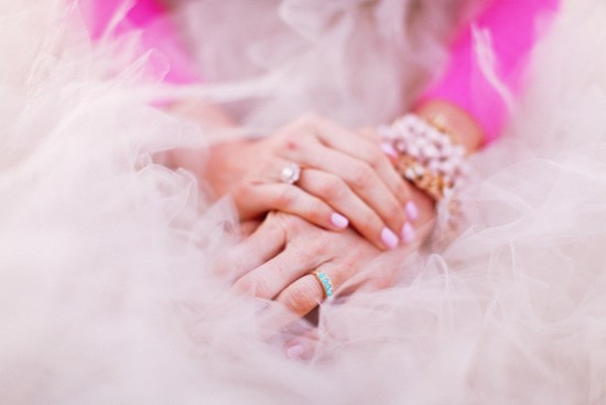 Princess Bride Wears Tulle Ball Gown With Pink Sweater and Nails