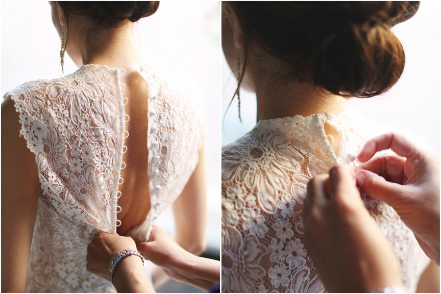 Bride-wears-lace-statement-back-wedding-dress-with-covered-buttons.full
