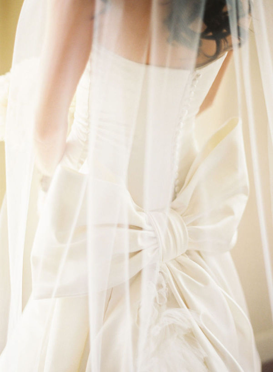 Bride-wears-vera-wang-wedding-dress-with-covered-buttons-down-back.full
