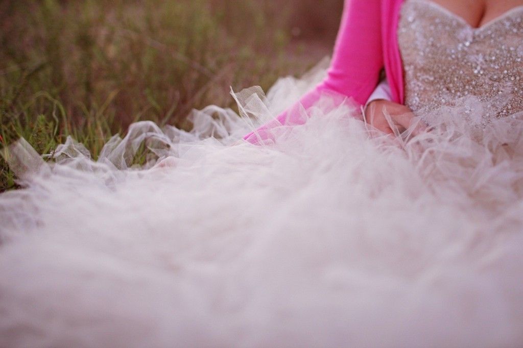 Bride-wears-beaded-ball-gown-with-pink-sweater.full