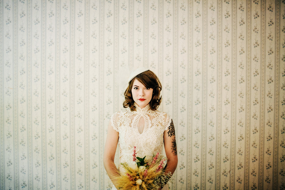 Tatted-up-bride-wears-lace-cap-sleeve-wedding-dress.full