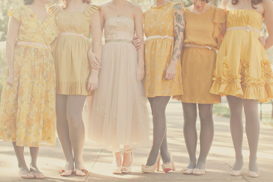 strapless nude wedding dress and bridesmaids in yellow