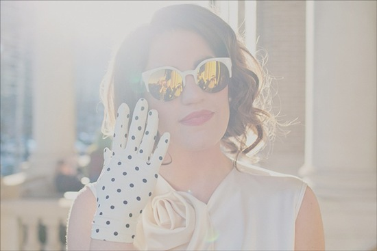 retro bride dons shades and polka dot gloves
