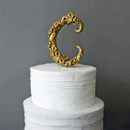 Gold monogram ornate wedding cake topper