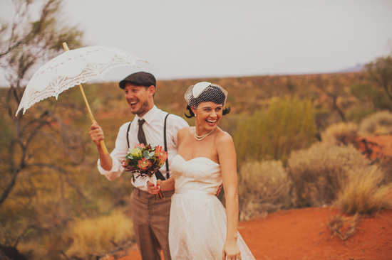 Eloped in Uluru - Bride poses with her groom beneath a lacy parasol