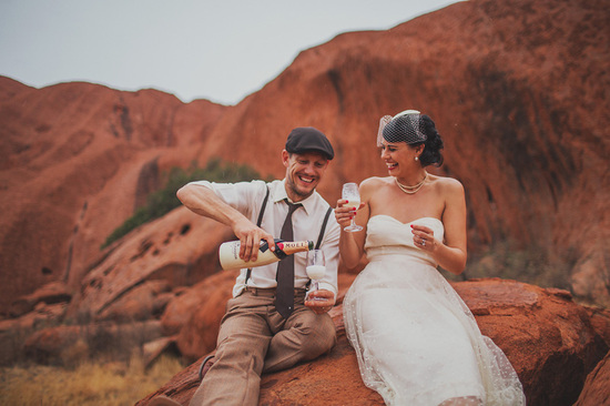 Eloped in Uluru - Popping champagne to celebrate