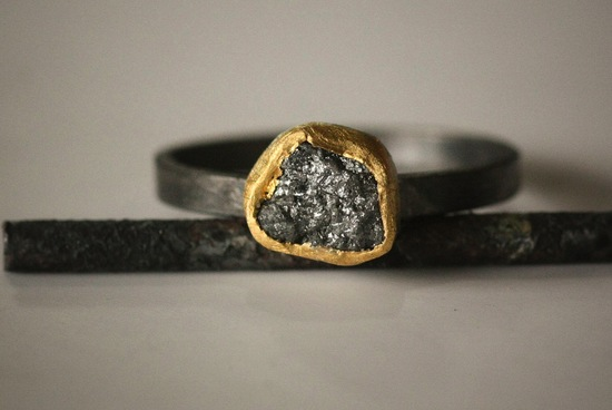 rough cut diamond engagement ring with gold halo