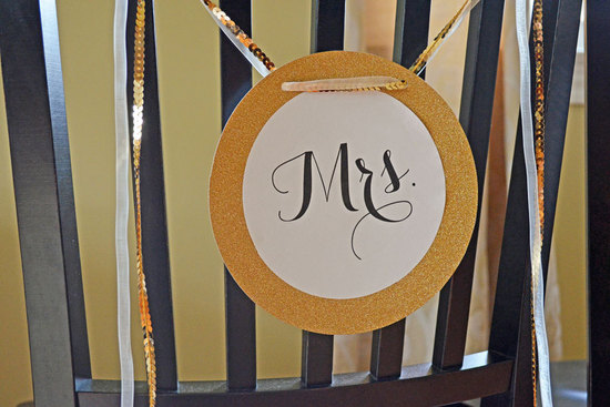 gold black and cream wedding chair signs